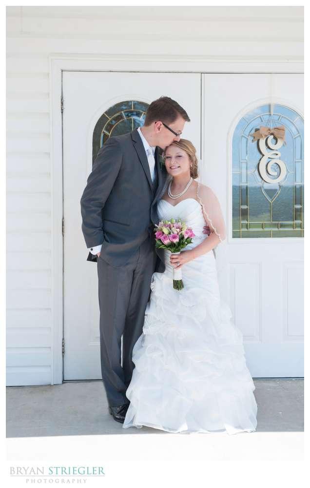 Arkansas Wedding couple in front of church