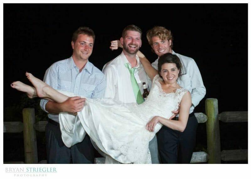 Whitney Mountain Lodge wedding holding bride