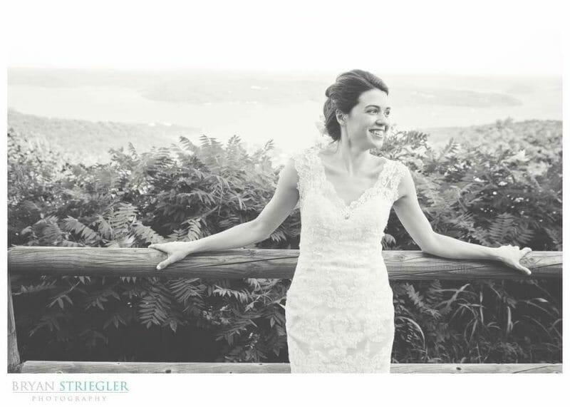 Whitney Mountain Lodge wedding bride leaning on fence