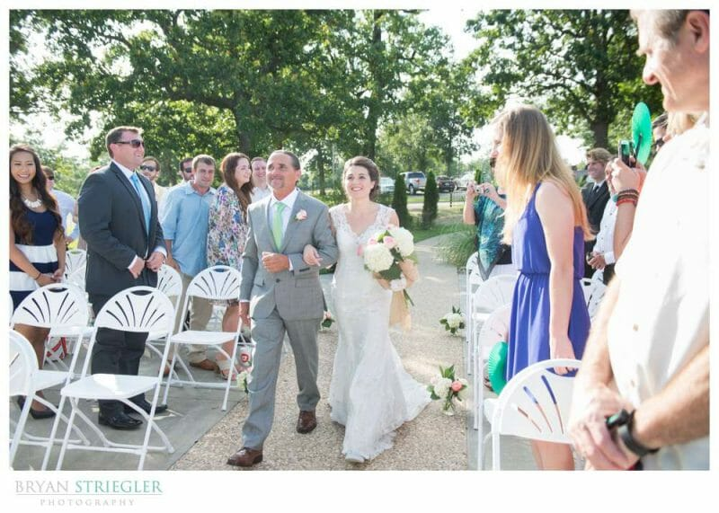 Whitney Mountain Lodge wedding walking down aisle