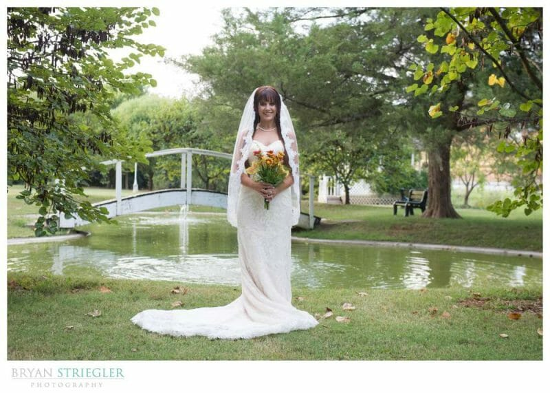 Ashley's Arkansas Bridal Portraits at Magnolia Gardens in front of pond