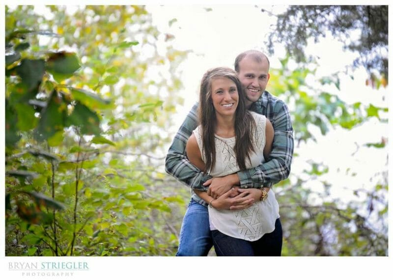 Arkansas Engagement Photos hugging from behind