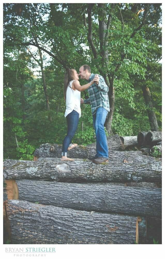 Arkansas Engagement Photos standing on logs