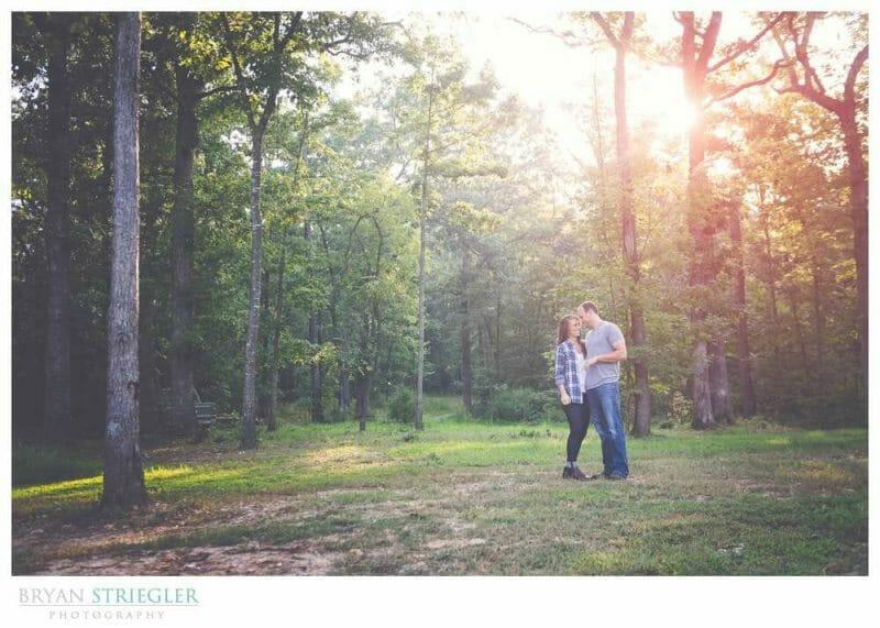 Arkansas Engagement Photos kissing in field