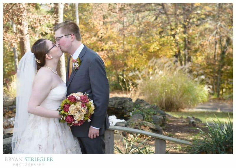 Eureka Springs Wedding Photographer kissing on bridge