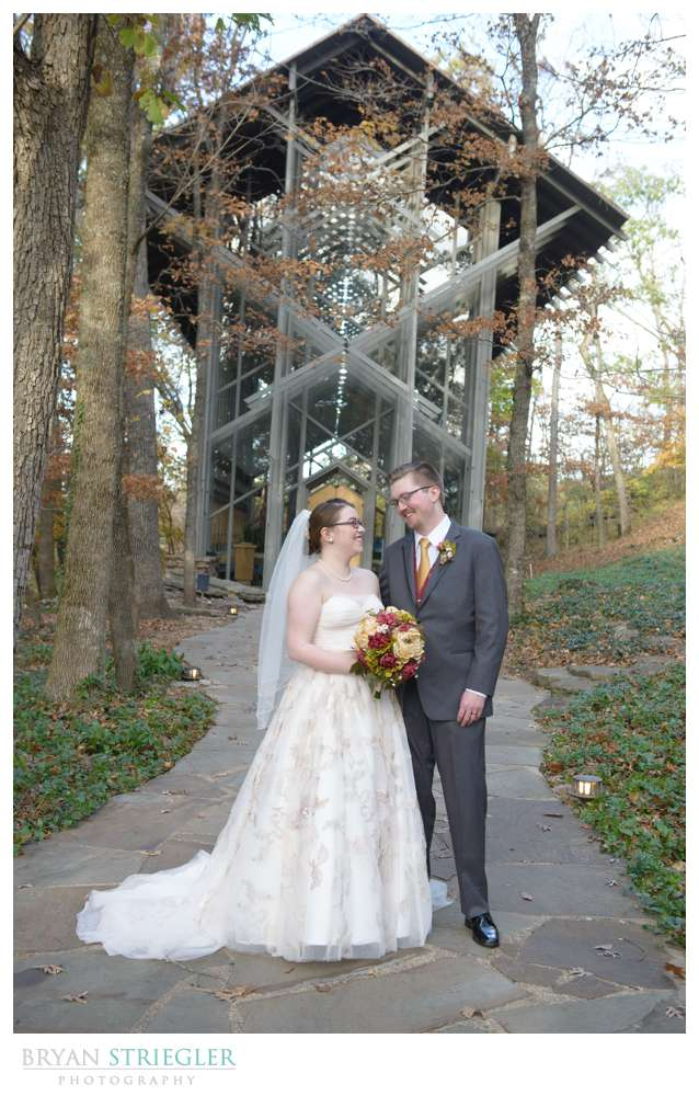 Eureka Springs Wedding Photographer couple in front of Thornecrown Chapel