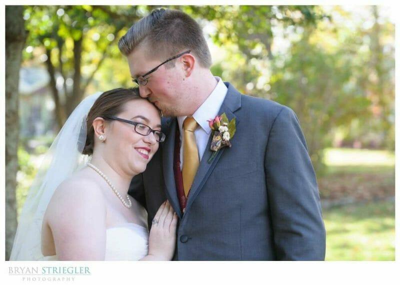 Eureka Springs Wedding Photographer kissing brides forehead