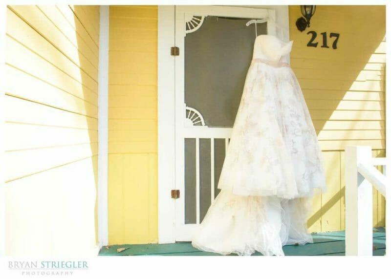 Eureka Springs Wedding Photographer dress hanging on porch