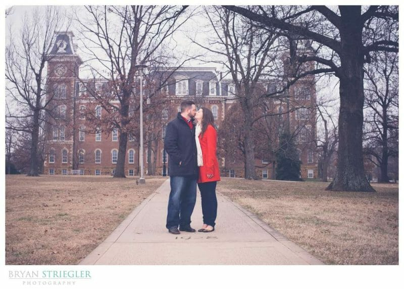Fayetteville Wedding Photographer kissing in front of Old Main