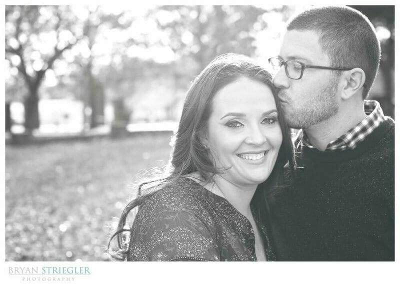 Engagements at Prairie Grove Battlefield Park kiss on the forehead