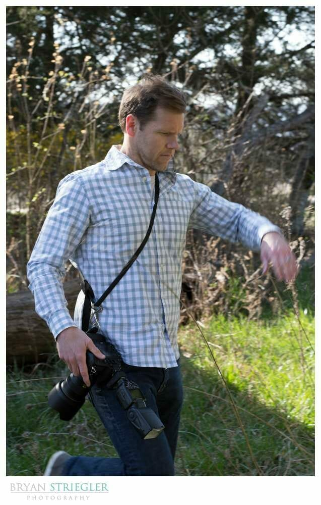 Having a Wedding Photography assistant walking through woods