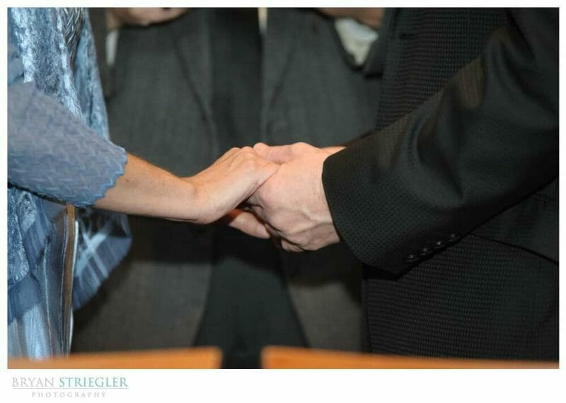 small, intimate wedding holding hands