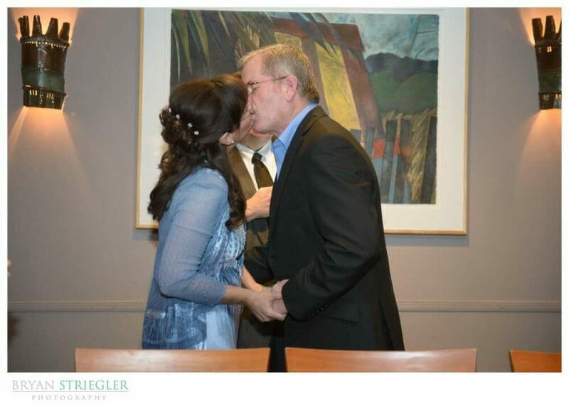 small, intimate wedding first kiss
