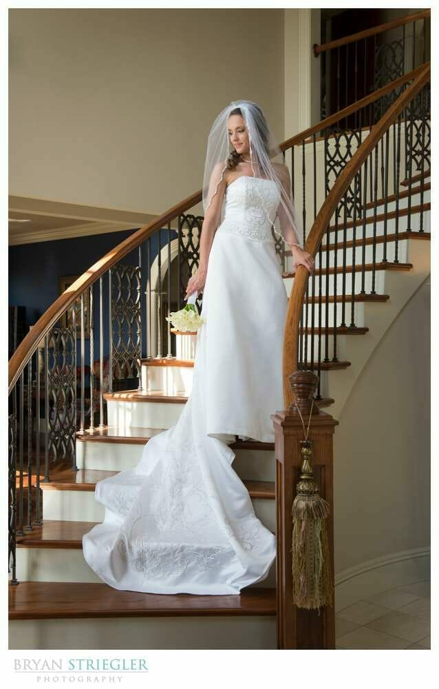 Staircase Bridal Portraits looking to the side with veil