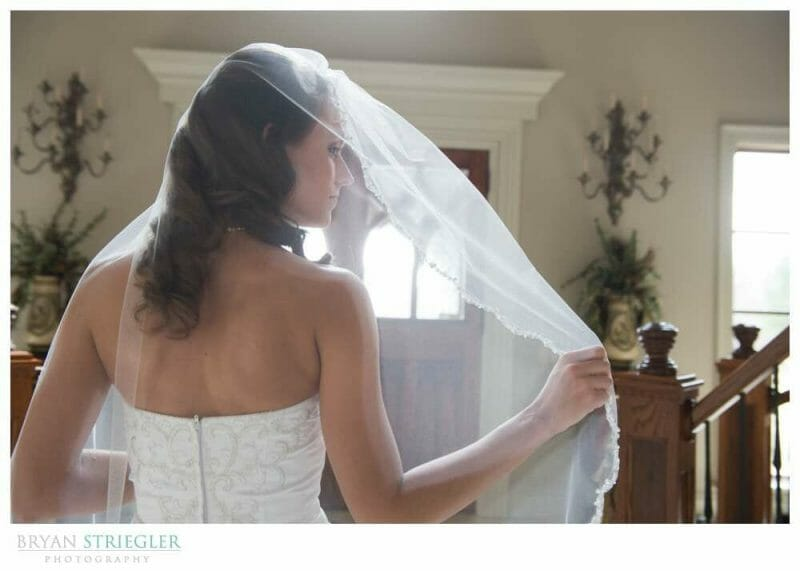 Staircase Bridal Portraits holding veil