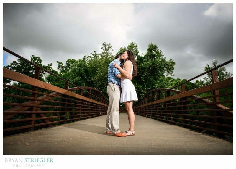 Arkansas Crossfit Engagement Photos on bridge with dark clouds