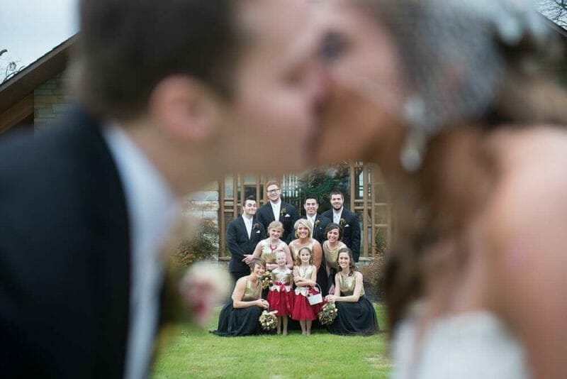Pinterest for Wedding Photography bridal party behind kissing couple