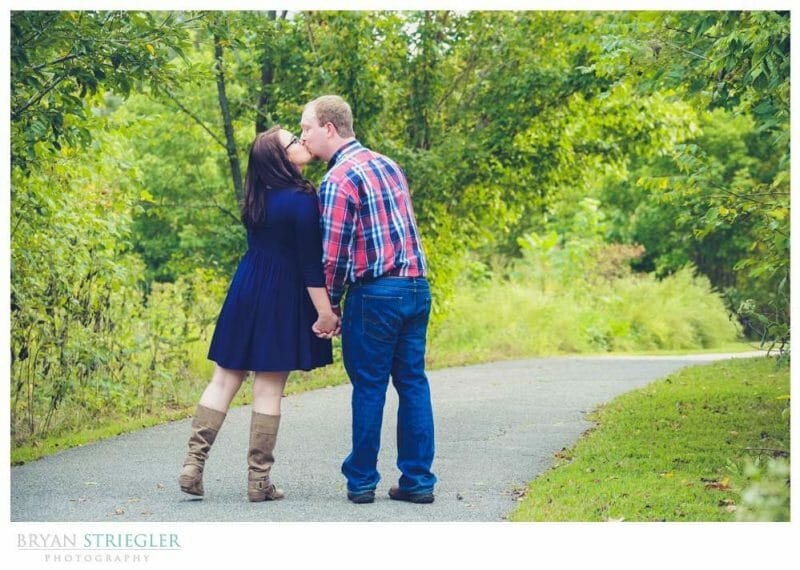 Kissing on trail engagement photos