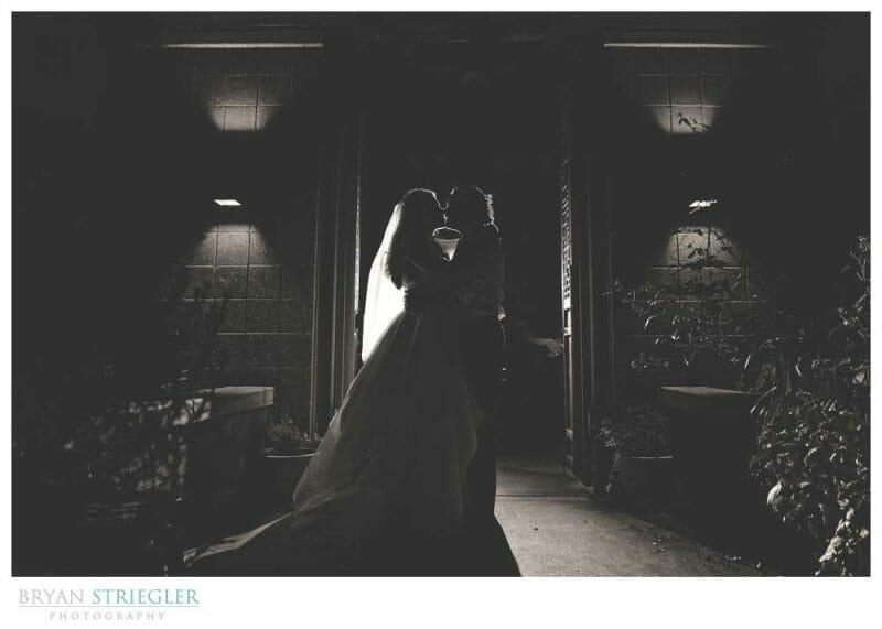 dramatic wedding portrait with back light