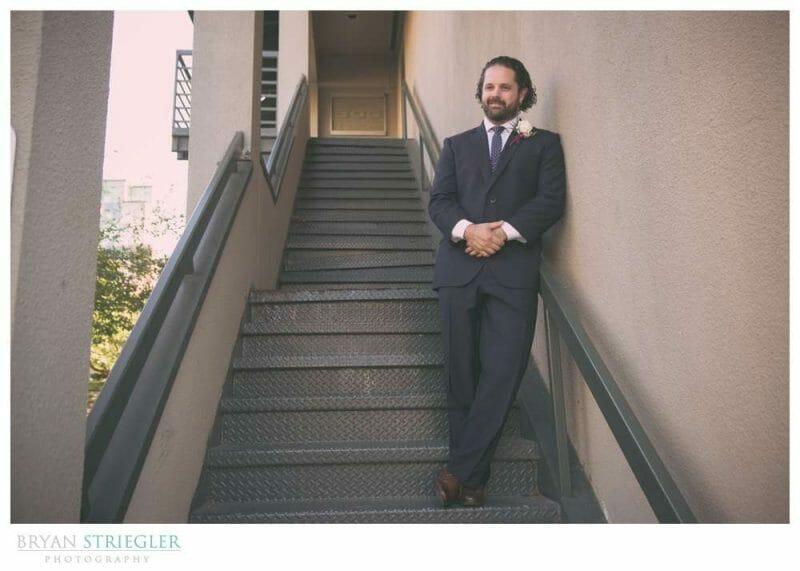 Groom posing on stairs