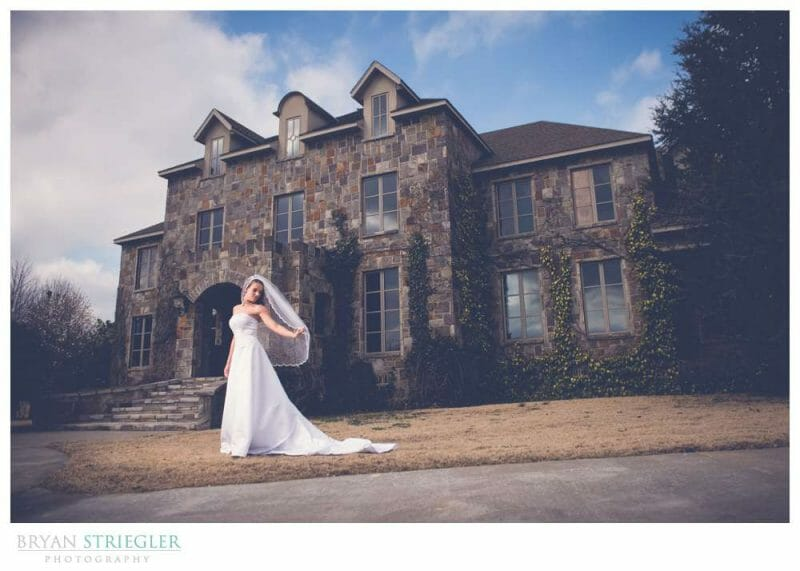 Bridal portraits in front of a large brick house