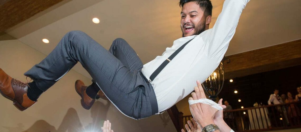 Tossing the groom into the air