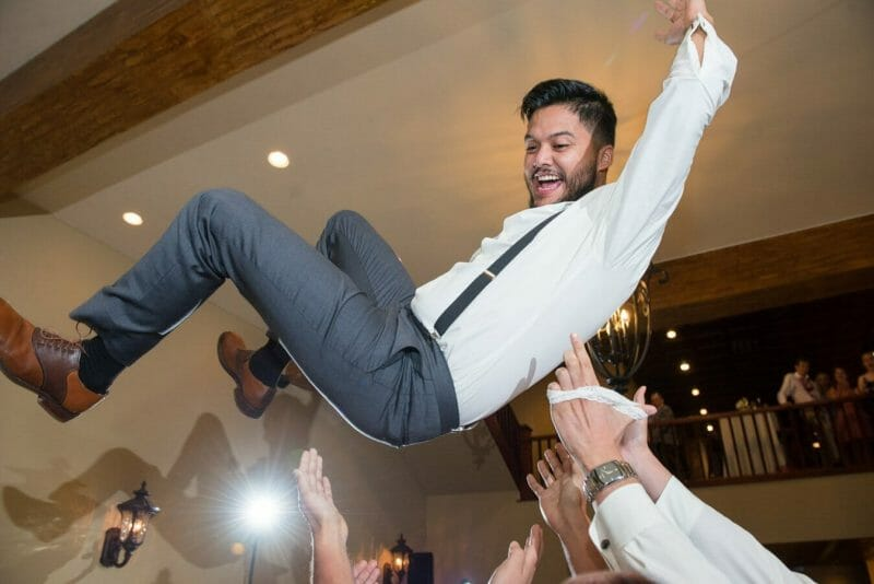 Tossing the groom at a wedding