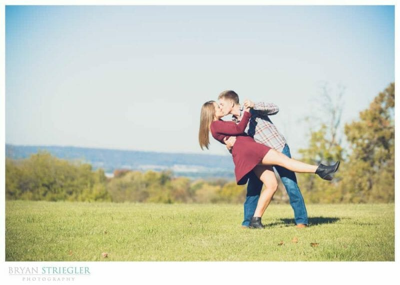 engagement photo dipping with blue sky
