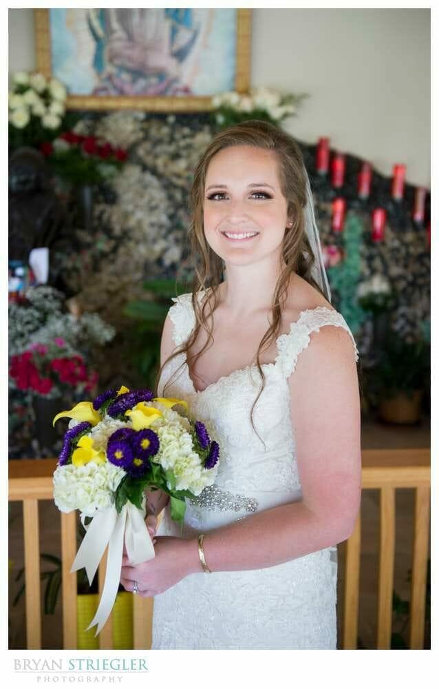 Bride posing at ceremony
