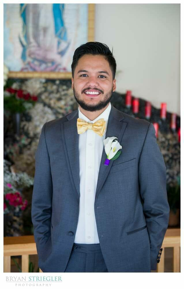 Groom posing during ceremony
