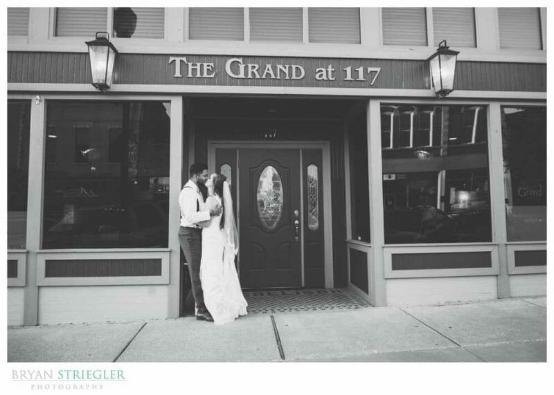 couple portrait in front of the Grand at 117