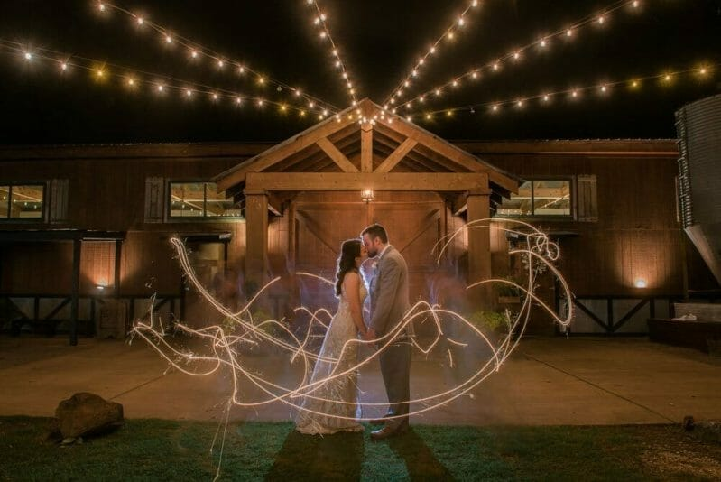 sparklers in front of Barn at the Springs