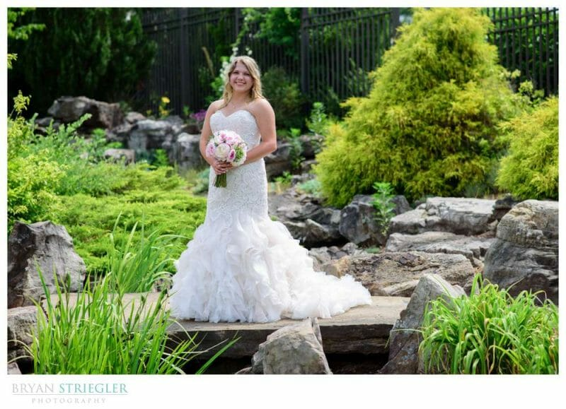 bridal portrait with small waterfall and trees