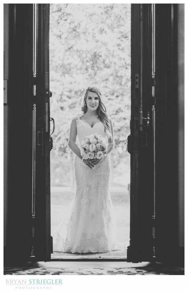 Bride walking through doors at Matt Lane Farm