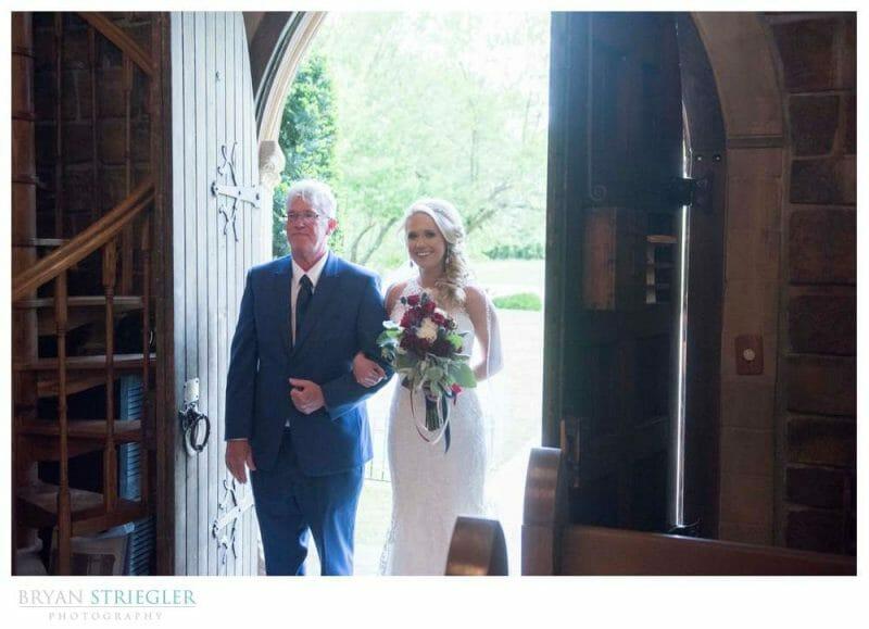 bride entering the stone chapel