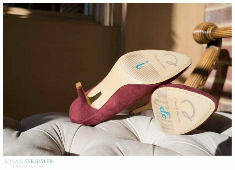 bride's shoes with message on bottom