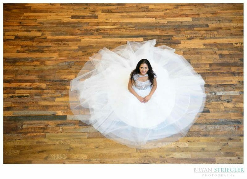 High angle photo of bride seated on floor
