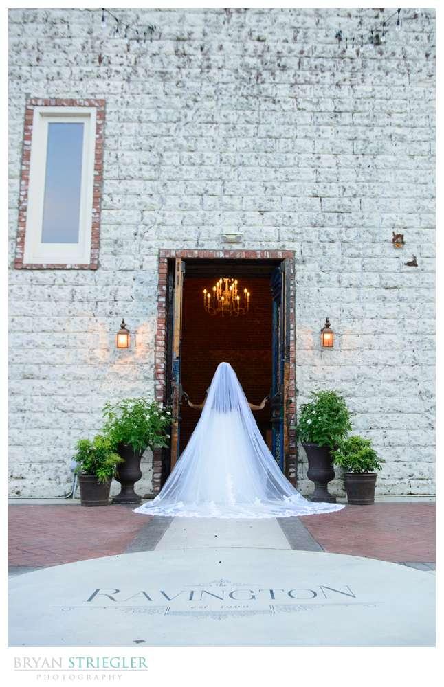 wide shot of bride in doorway
