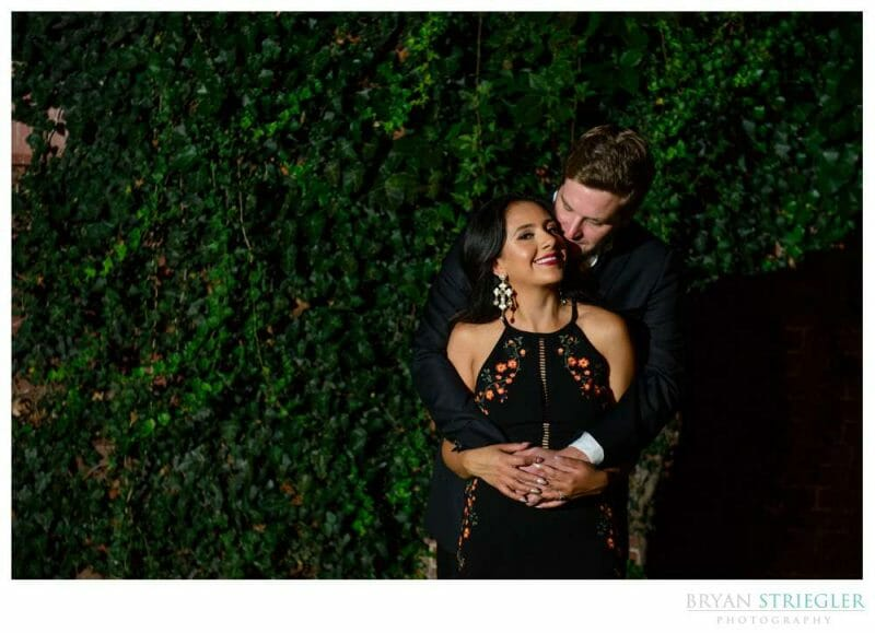 engagement photo with ivy covered wall