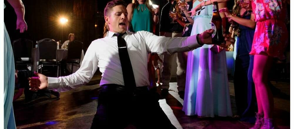 groomsmen dancing and sliding