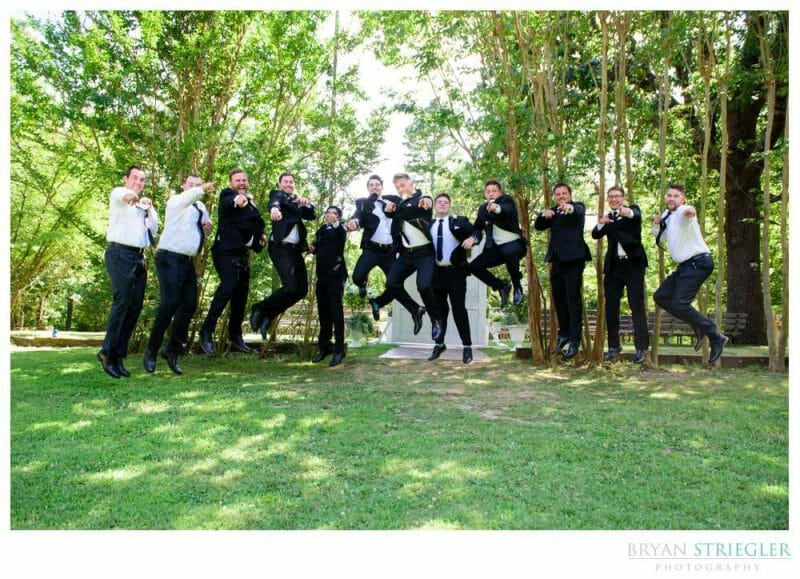 Groomsmen jumping into the air