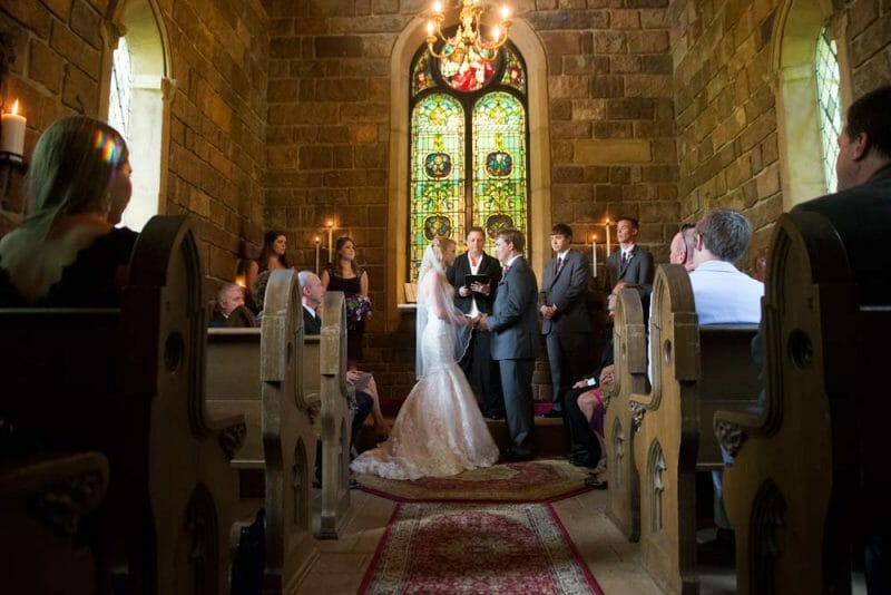 Ceremony inside the stone chapel at St. Catherine's at Bell Gable