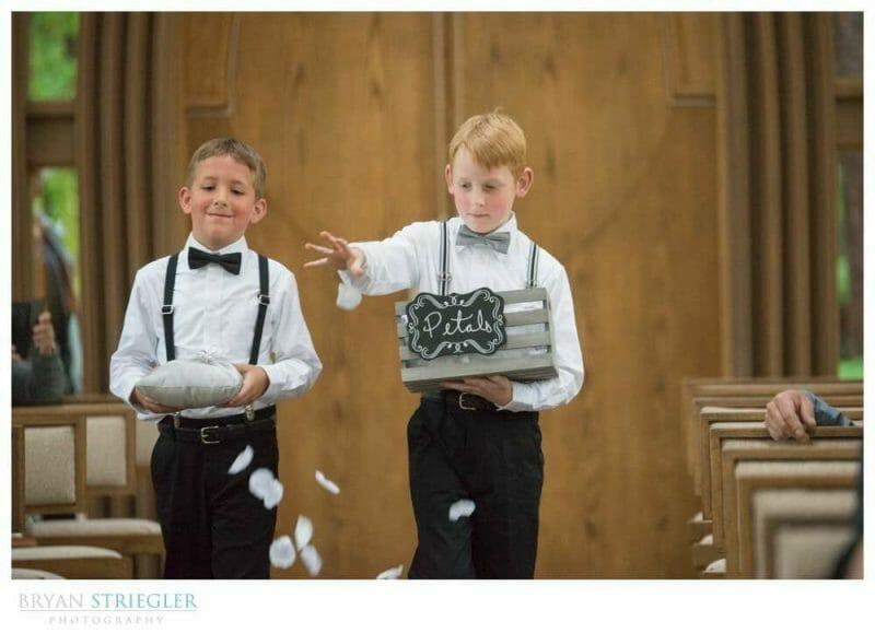 ring bearer and boy tossing flower petals