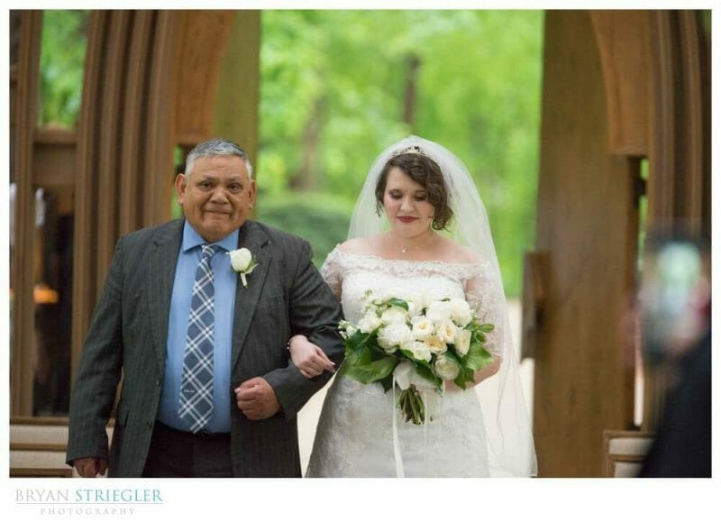 father and bride walking the aisle at Mildred B. Cooper Chapel