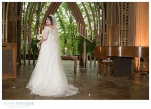 bride portrait on stage at Mildred B. Cooper Chapel