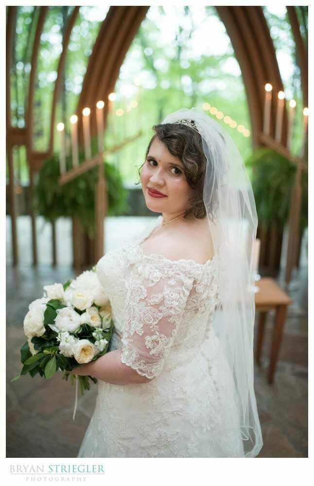 bride portraits with candles in the background