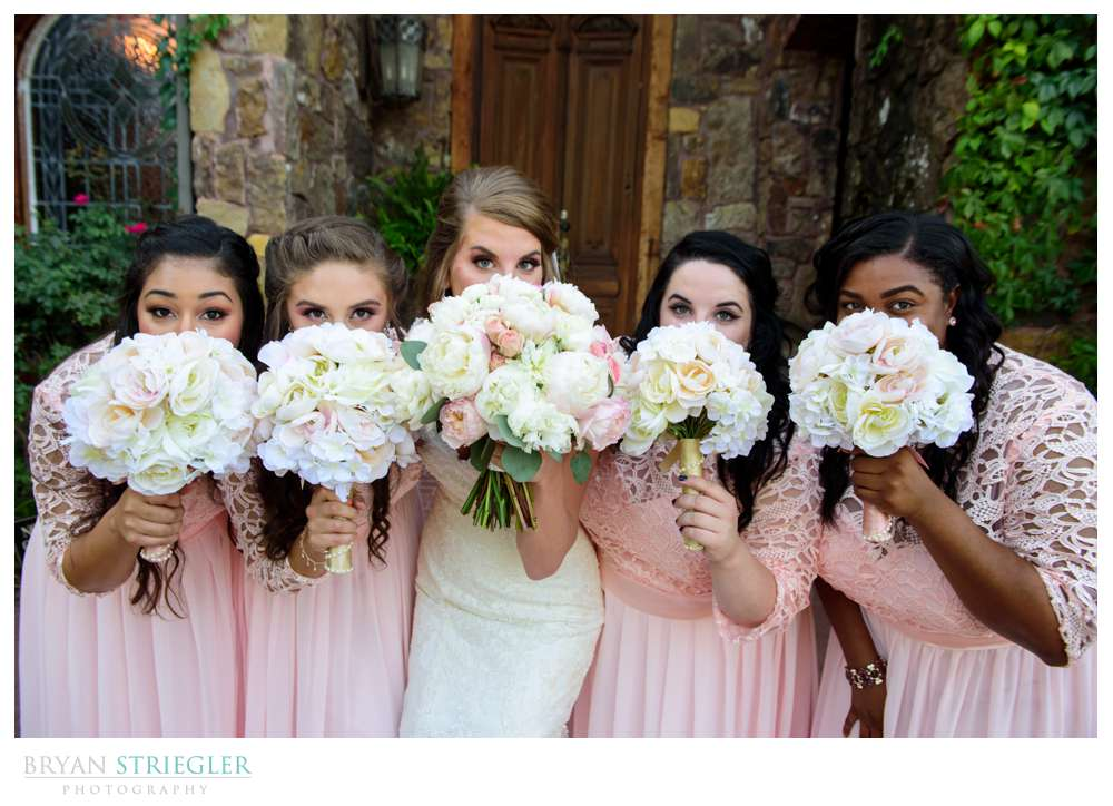 bride and girls hiding behind flowers