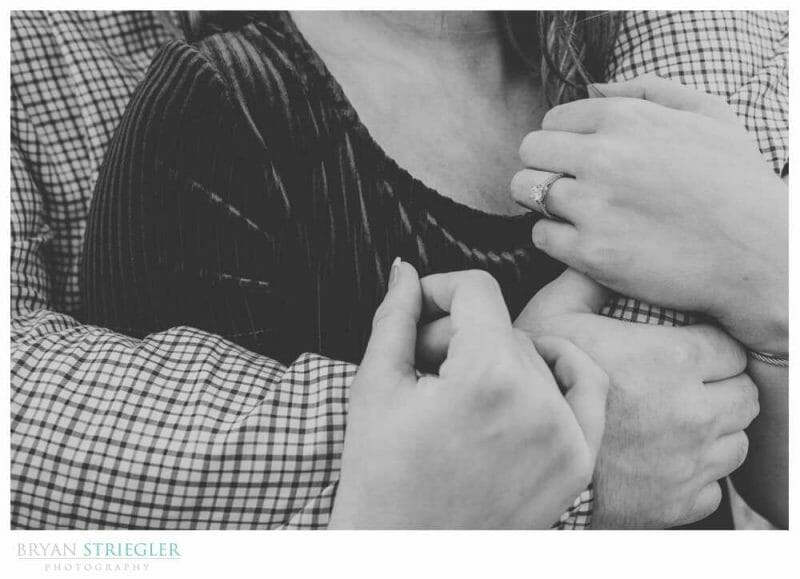 close up of hands in engagement shoot