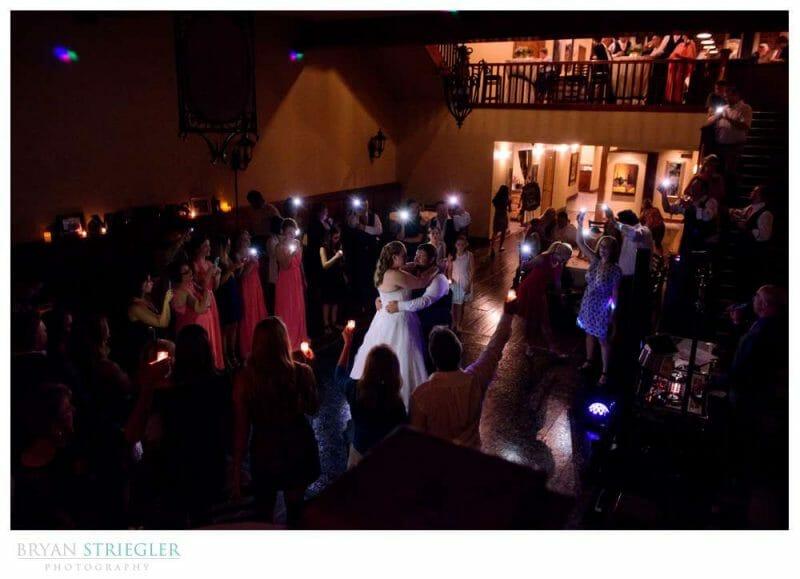 wedding couple dancing to phone lights
