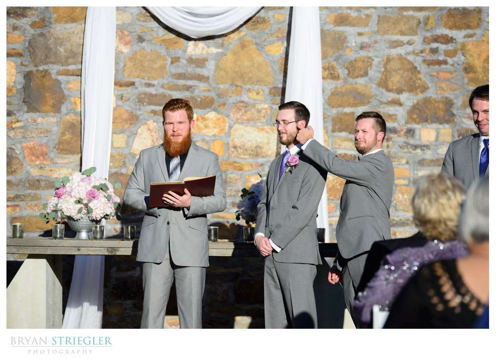 bestman giving a wet willy to groom